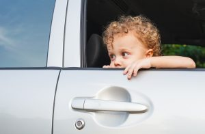 sad boy near car window